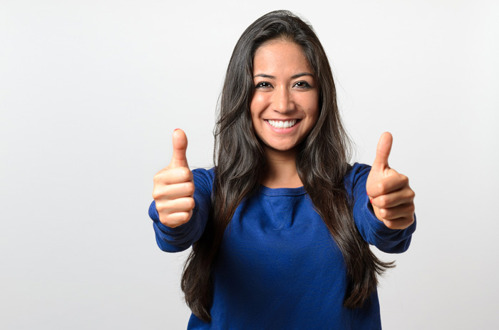 Woman doing a thumbs up sign