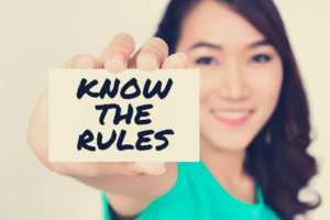 Woman holding a know the rules sign